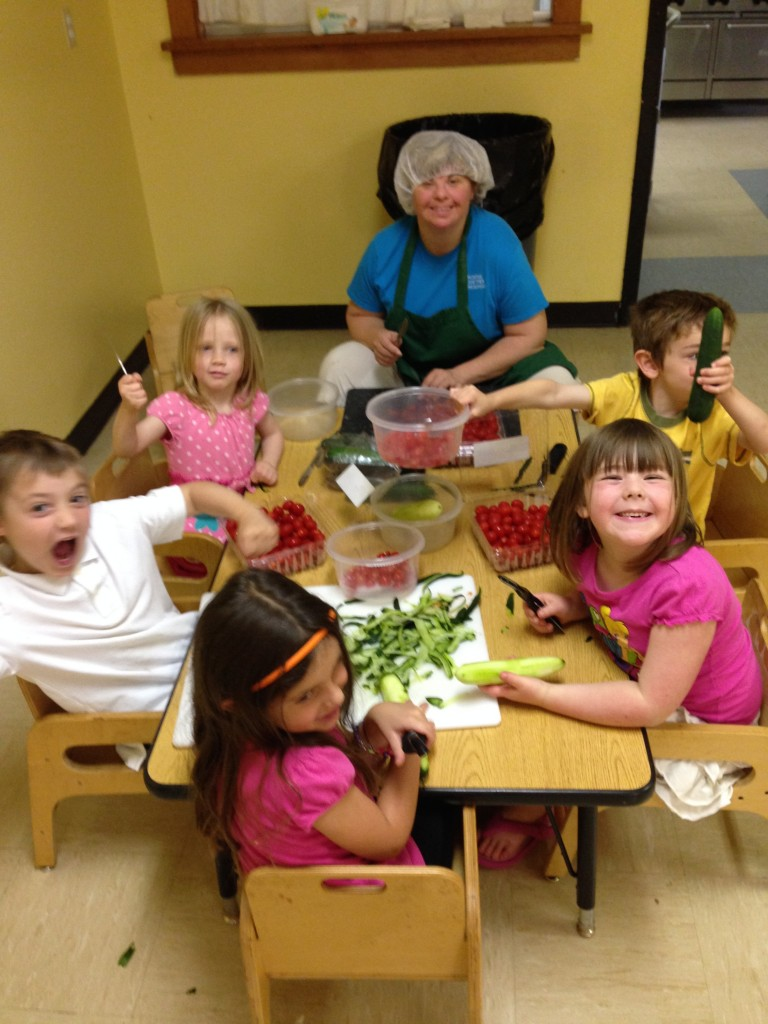 Leeann and PreKindergarteners preparing chef salad for lunch and loving it!