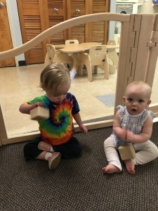 Juno and friend play with musical blocks.