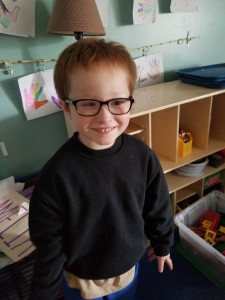 Aiden now - looking handsome in his new glasses!